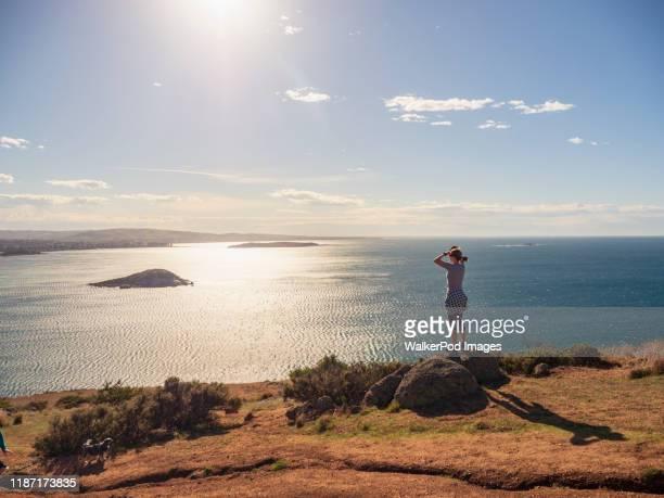 woman looking at view of victor harbor, south australia, australia - südaustralien stock-fotos und bilder
