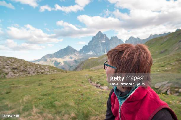 Woman Looking At View On Field Against Sky