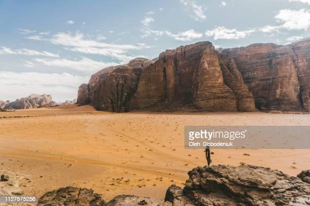 Woman looking at  Wadi Rum desert from rock