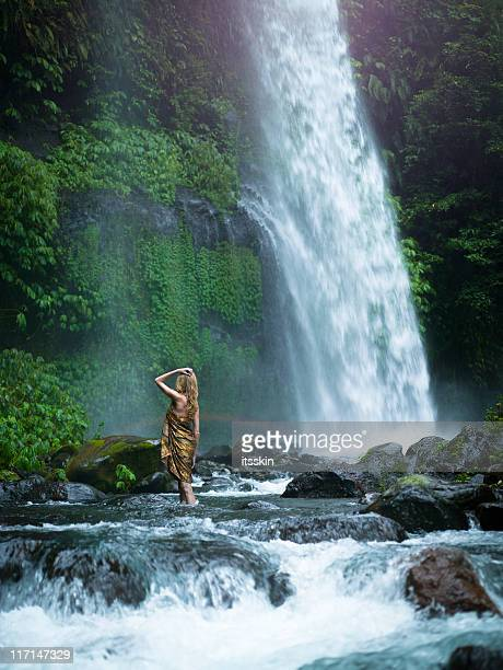 woman looking at waterfall - tall blonde women stock photos and pictures
