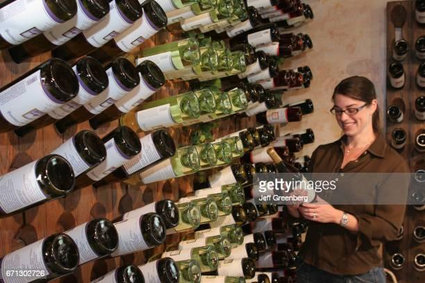Woman looking at wine bottles in Bowers Harbor Vineyards.