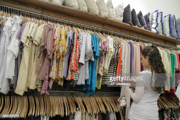 A woman looking at women's clothes in Bloomingdale's at Aventura Mall