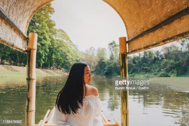 Woman Looking Away In Houseboat Over River