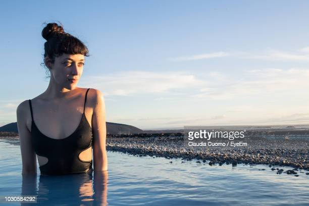 woman looking away in sea against sky - cuomo stock pictures, royalty-free photos & images