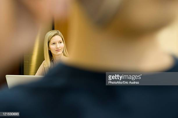 woman looking away in thought, man in foreground - unusual angle stock pictures, royalty-free photos & images