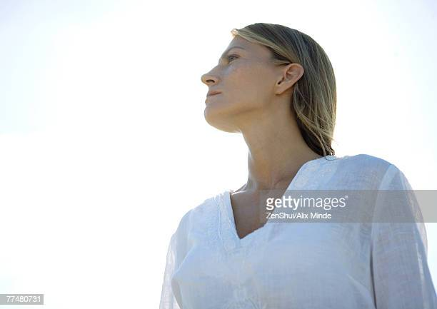 Woman, looking away, low angle view, portrait