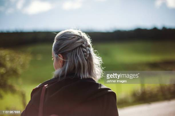 woman looking away - rear view stock pictures, royalty-free photos & images