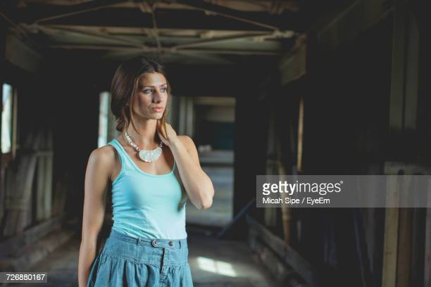 woman looking away - sleeveless top stock photos and pictures