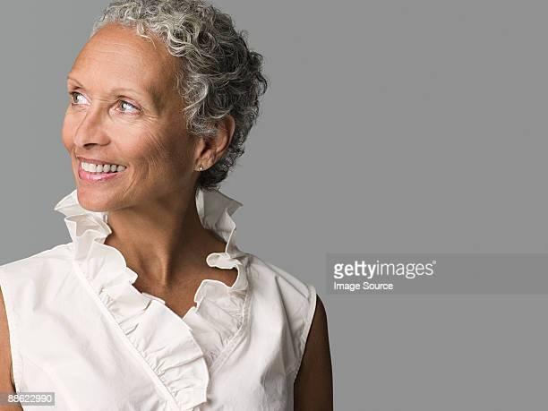 woman looking away - chemisier photos et images de collection