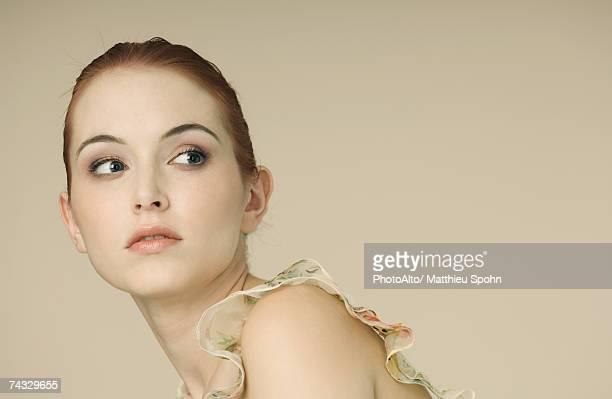 Woman looking away, portrait
