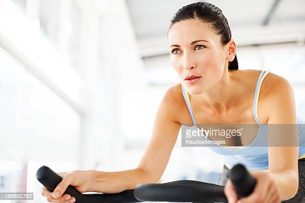 Woman Looking Away While Spinning In Health Club
