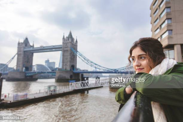 woman looking busy and energetic cityscape of london - emigration and immigration stock pictures, royalty-free photos & images