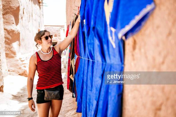 woman looking clothing of the city of ouarzazate in morocco - souvenir stock pictures, royalty-free photos & images