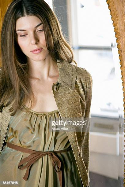 woman looking down - alexa grace stock pictures, royalty-free photos & images