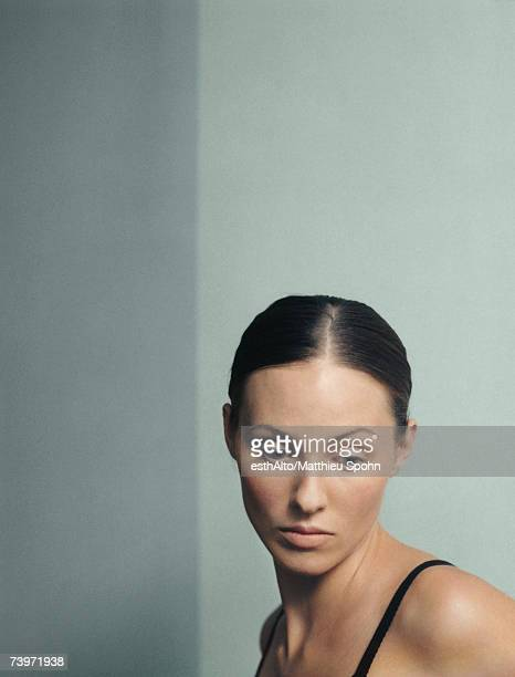 woman looking down, portrait - hair part stock pictures, royalty-free photos & images