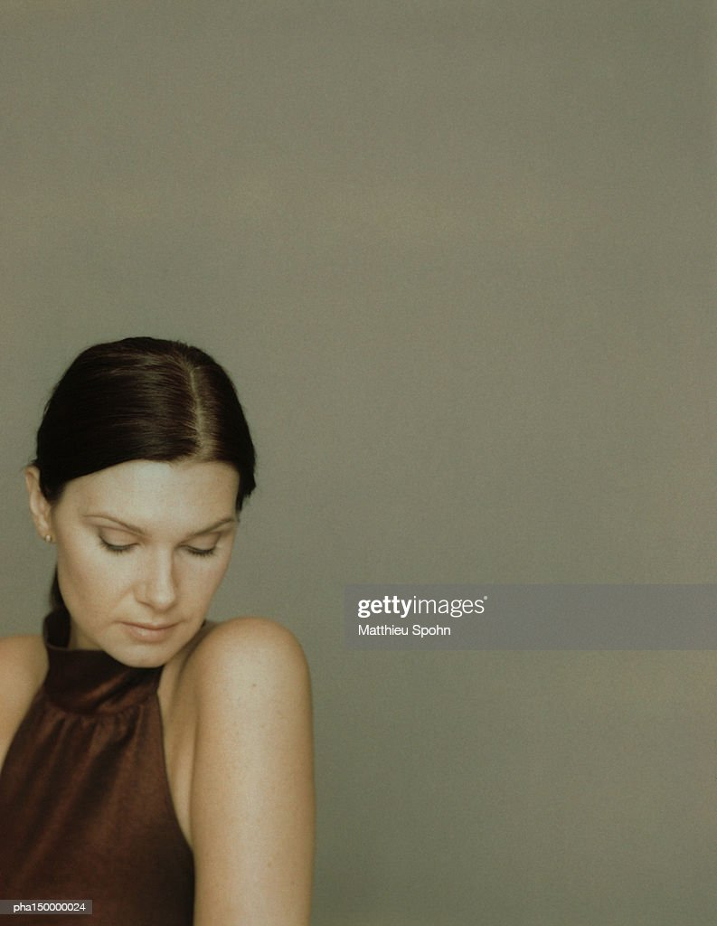 Woman looking down, portrait : Stock Photo