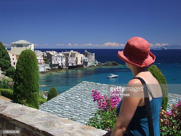 woman looking down to erbalunga - corsica stock photos and pictures