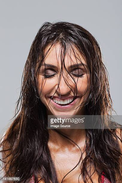 woman looking euphoric - wet hair stock pictures, royalty-free photos & images