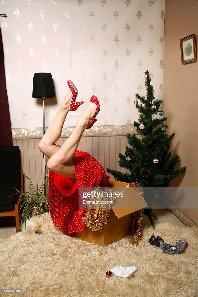 woman looking for Christmas decoration in a box : Stock Photo