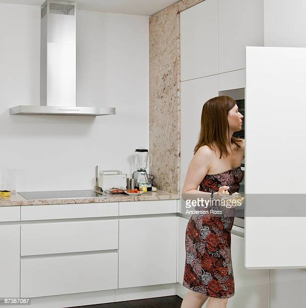 Woman looking for food in the cupboards