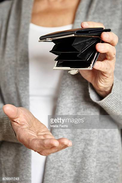 Woman looking for loose change in coin purse