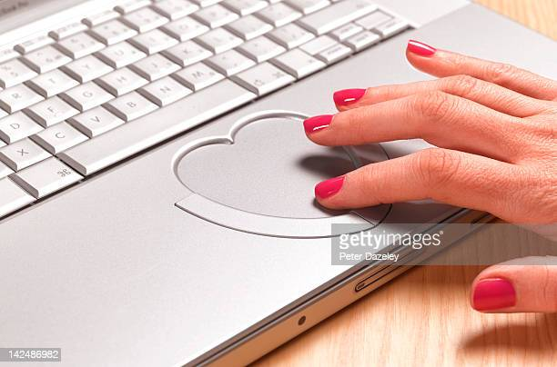 woman looking for love online - online dating stock pictures, royalty-free photos & images