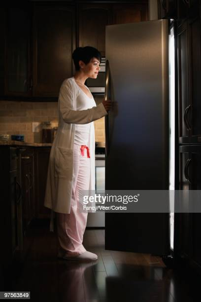 Woman Looking in a Refrigerator