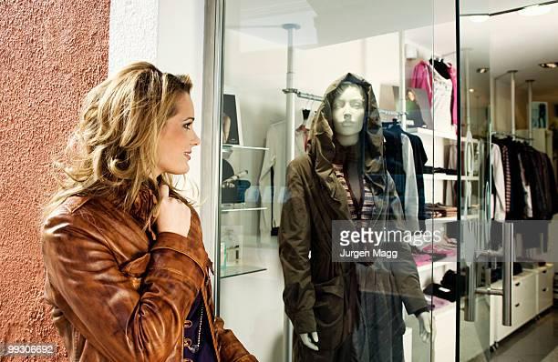 A woman looking in a shop window