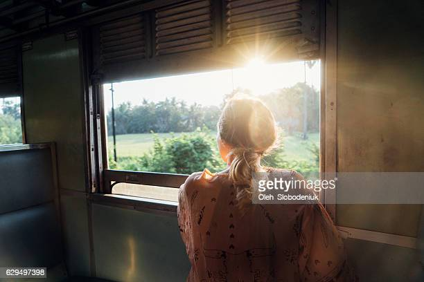 Woman looking in the train window