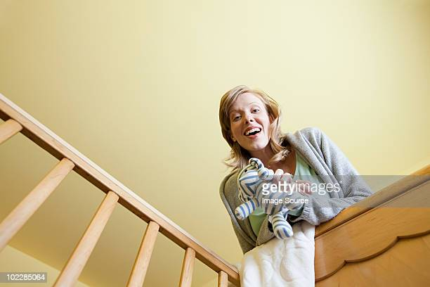 Woman looking in to crib