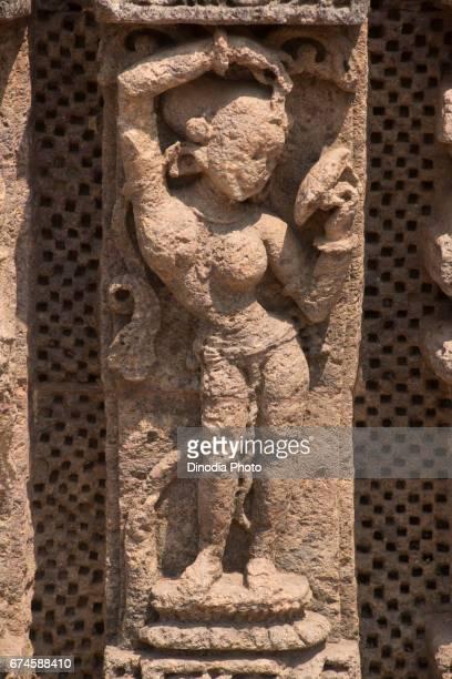 Woman looking in to mirror sculpture, sun temple, konark, orissa, india, asia