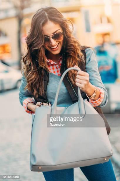 Woman looking inside her bag