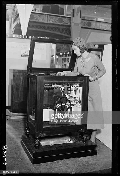 Woman looking into a radiogram at Radiolympia Olympia London 1932 A photograph taken by George Woodbine for the Daily Herald newspaper on 18 August...