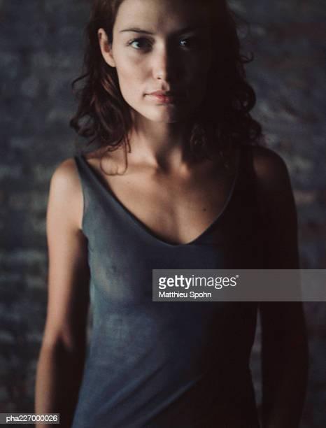 Woman looking into camera, portrait.