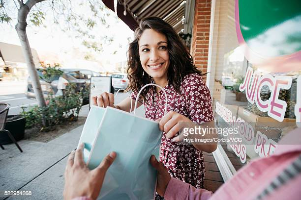Woman looking into gift bag