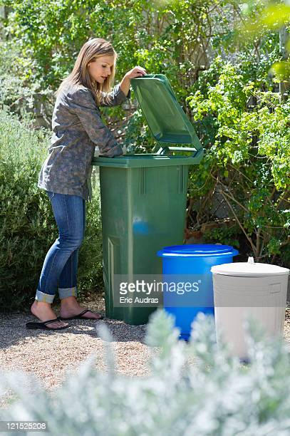 woman looking into recycling bin - lid stock photos and pictures
