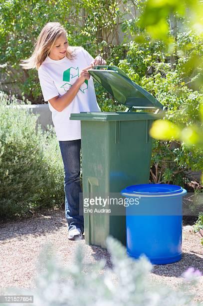 woman looking into recycling bin - lid foto e immagini stock