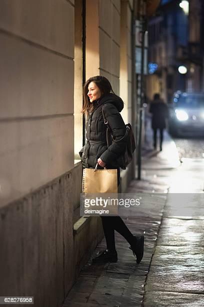 Woman looking into shopwindow.