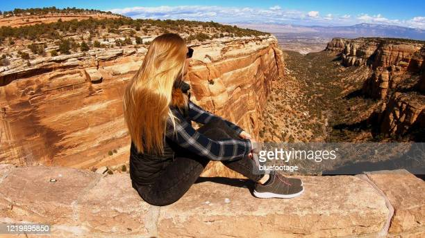woman looking into the canyon - bluefootage stock pictures, royalty-free photos & images