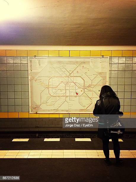 Woman Looking Map At Subway Station