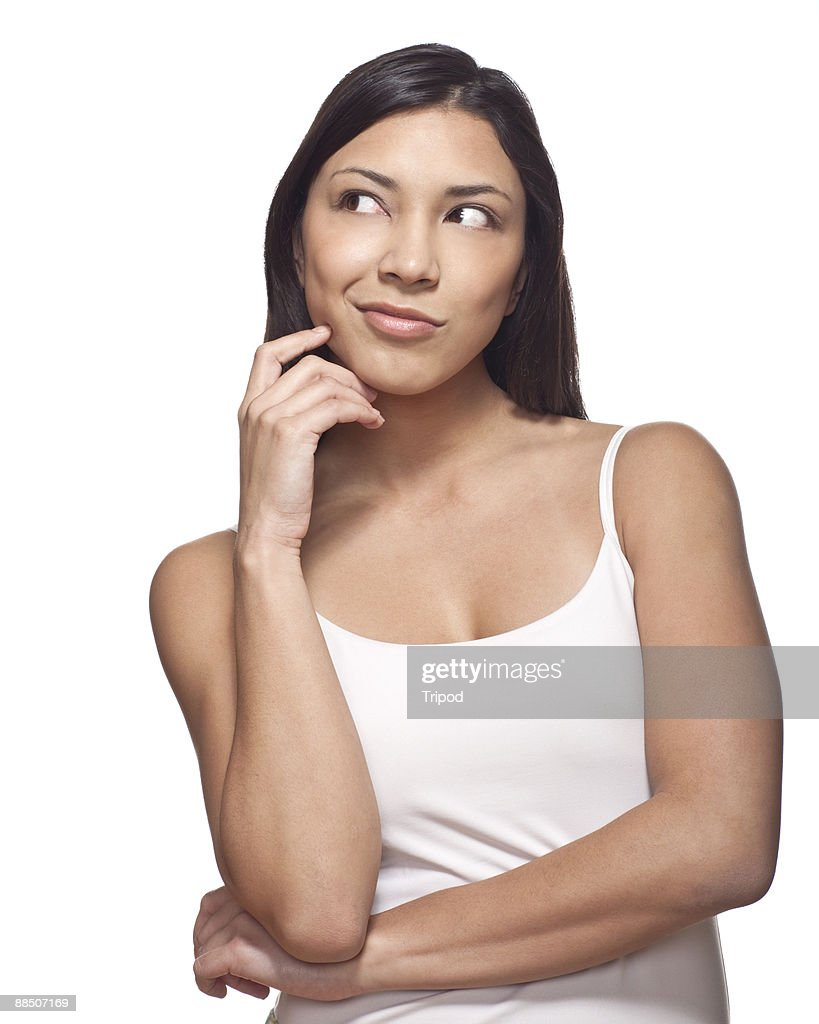 Woman Looking Off To Side Hand On Face Stock Photo Getty Images