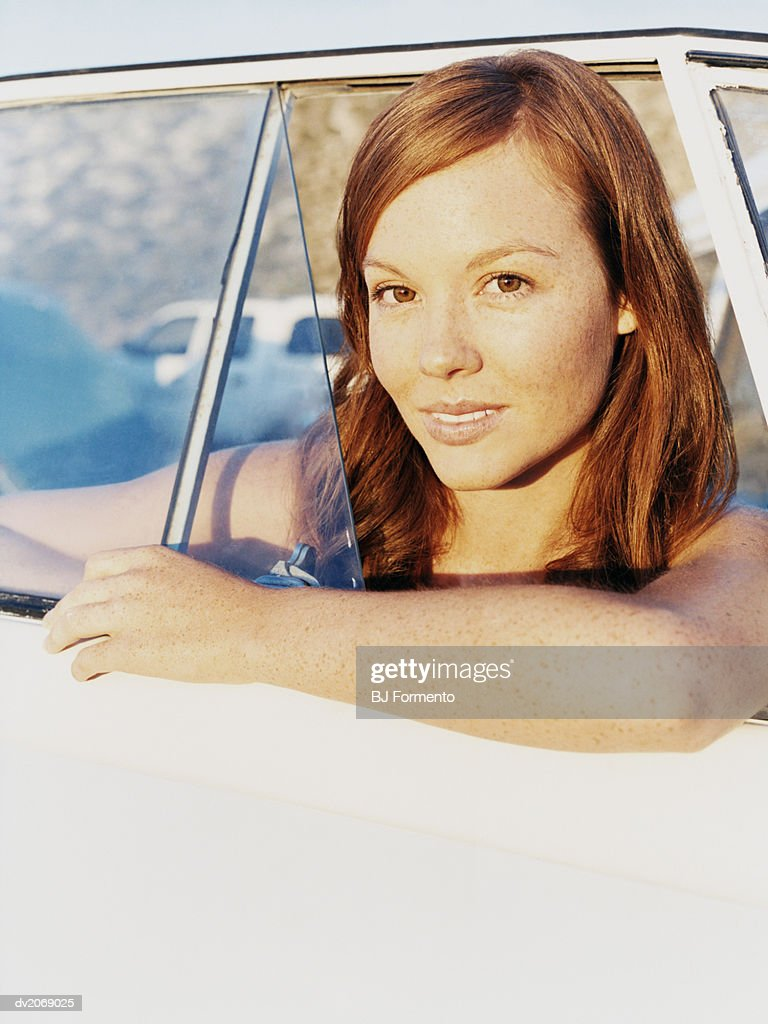 Woman Looking out a Window of a Camping Van : Stock Photo