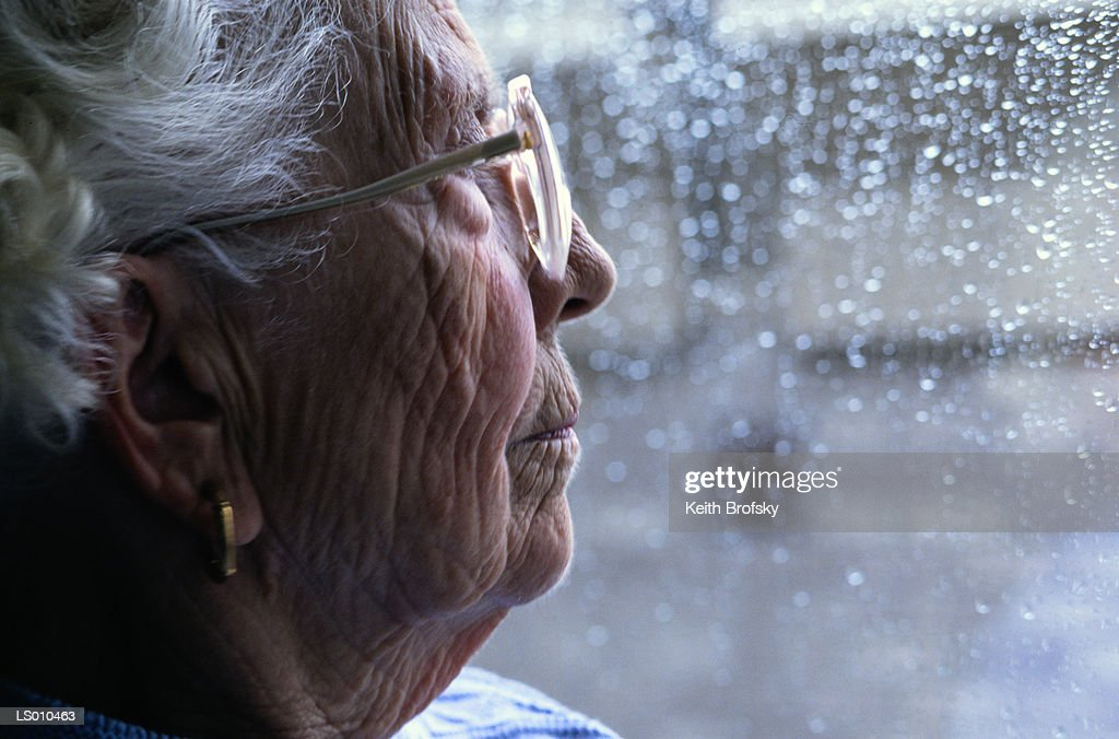 Woman Looking out a Window : Stock Photo