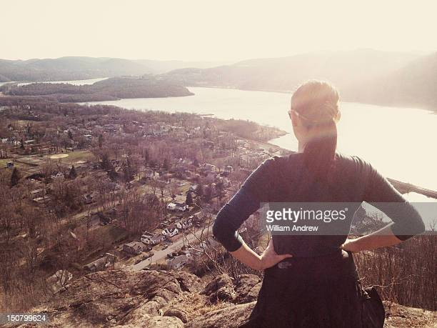 Woman looking out from mountain vista