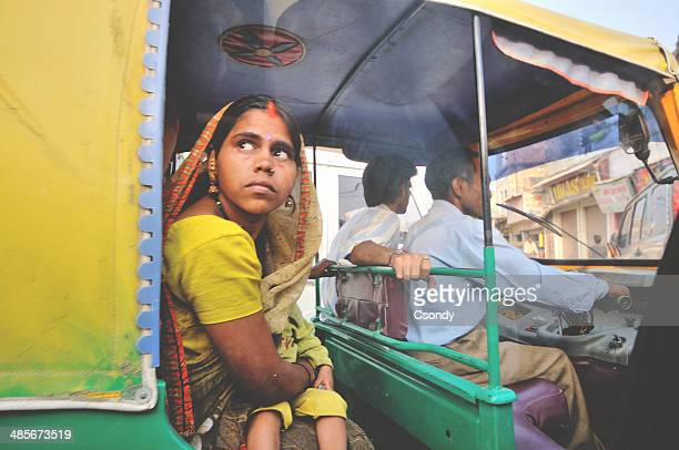 Woman looking out from the tuk tuk in India