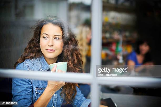 Woman Looking out of a Cafe Window