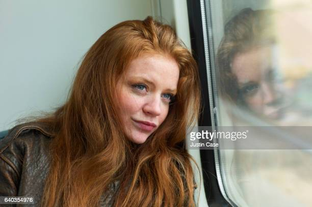 Woman looking out of a train window