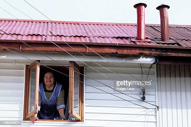 woman looking out of a window. - puerto montt fotografías e imágenes de stock