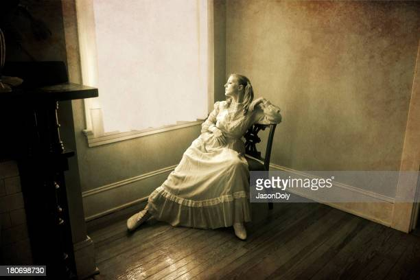 woman looking out of a window - 19th century style stock pictures, royalty-free photos & images