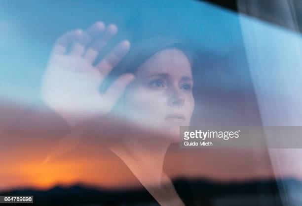 woman looking out of a window. - desire stock pictures, royalty-free photos & images